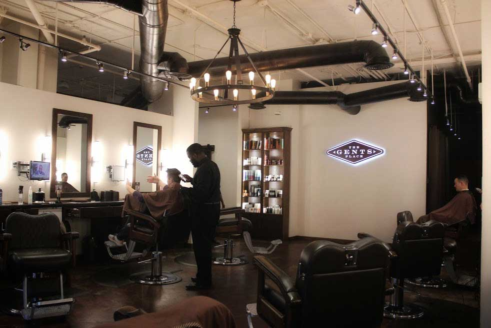 Man in barbers chair The Gents Place Uptown Dallas